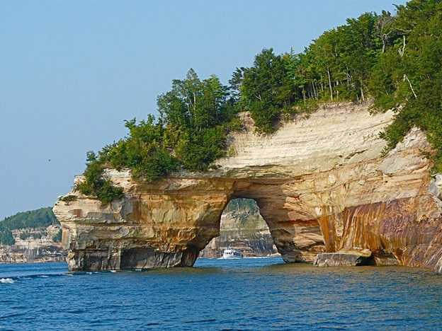 Image shows the famed rock arch formation as seen from the tour boat at Pictured Rocks National Lakeshore, Michigan.