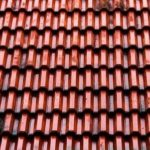 How to Choose Between Metal and Shingle Roofs