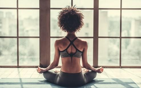 girl sitting on floor in yoga pose