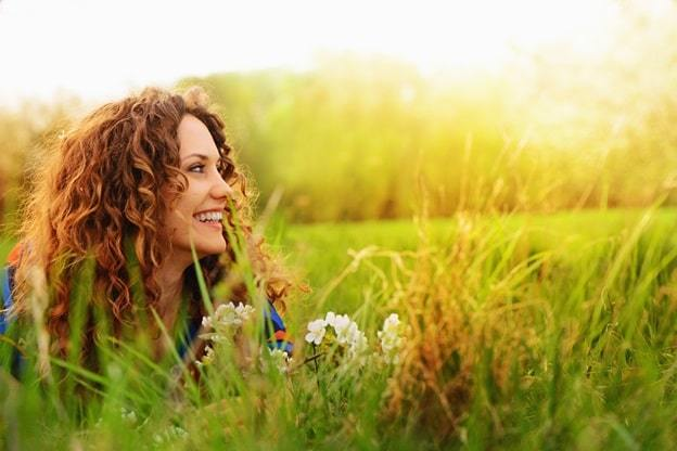 girl smiling in the field