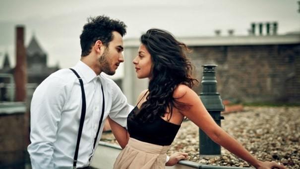 couple standing with eye-to-eye contact