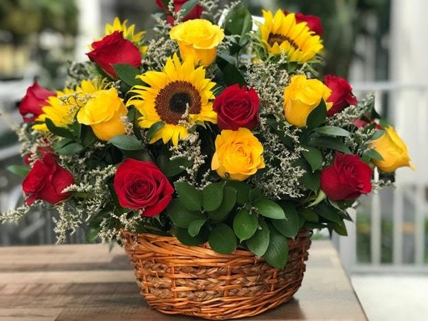 yellow lilies and red carnations basket