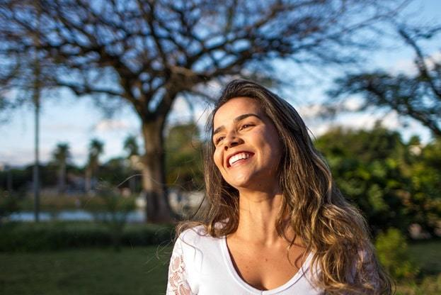 person smiling in nature