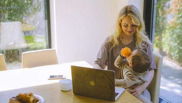 mom smiling with baby at work