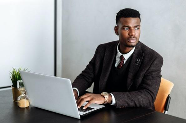 person sitting at computer desk