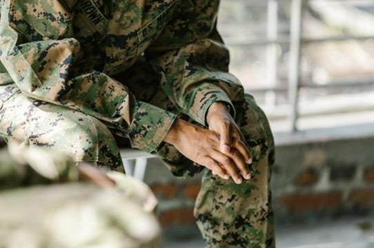 army man sitting on chair
